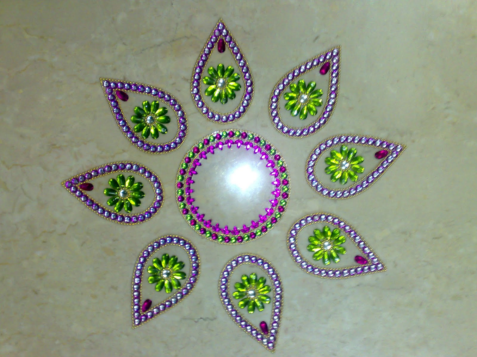 20 Amazing Free hand Rangoli Designs for Competition 14